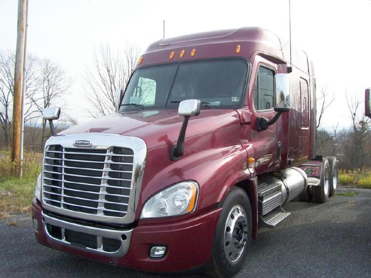 Front left red 2009 Freightliner Cascadia Truck Picture