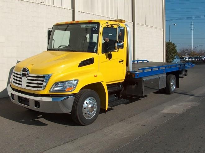 Front Left Yellow 2009 Hino 258 Truck Picture