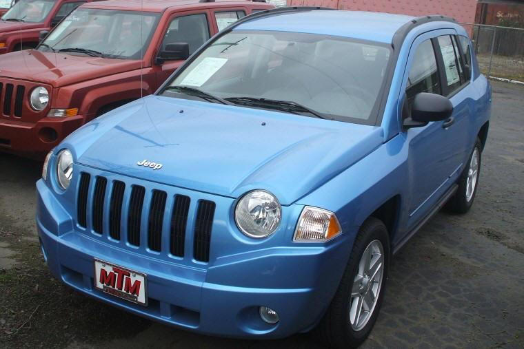 Front left blue 2009 Jeep Compass Truck Picture