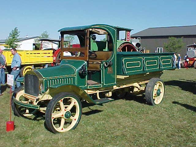 Front Left Green 1916 Mack Model AB Dump Truck Picture
