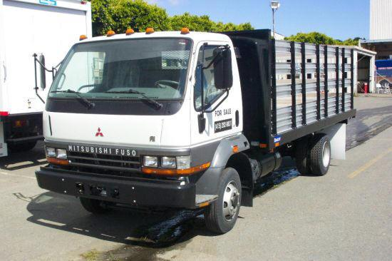Front Left White Mitsubishi Stake Truck Picture