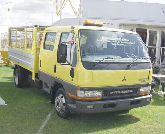 Front Right Yellow 2004 Mitsubishi Canter Truck Picture