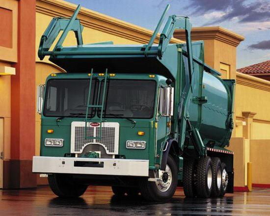 Front left green Peterbilt Model 320