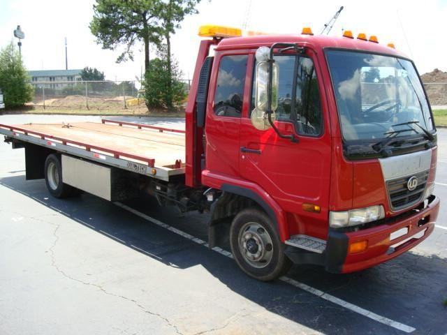 Front Right Red 2006 UD Nissan 2000 Truck Picture
