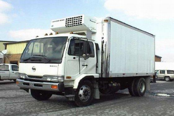 Front left white 1999 UD 2600 truck picture.