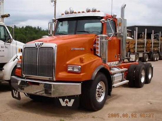 Front left orange 2006 Western Star 4964SA truck picture.