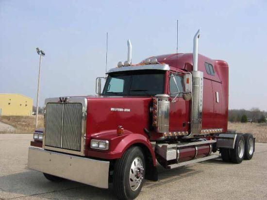 Front left maroon 2003 Western Star 4964EX truck picture.