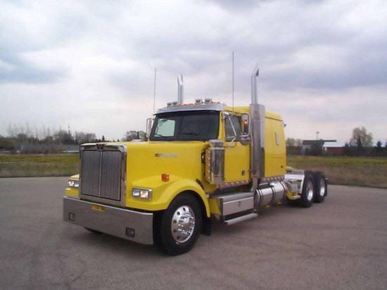 Front left yellow 2005 Western Star 4900EX truck picture.